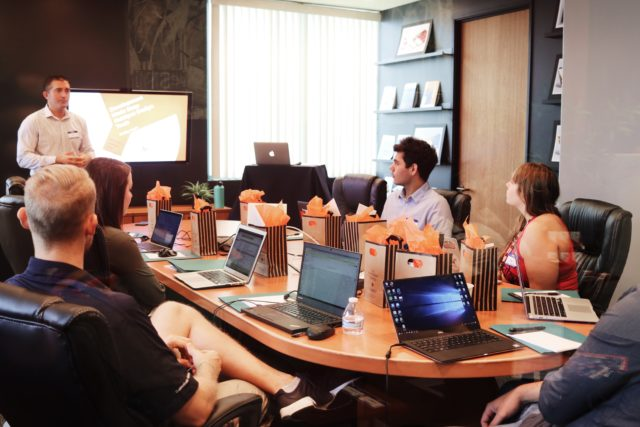 Employee workplace training in meeting room